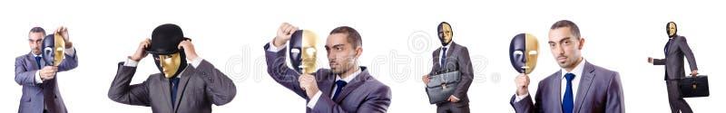 Ο επιχειρηματίας με τη μάσκα στην έννοια υποκρισίας στοκ εικόνα