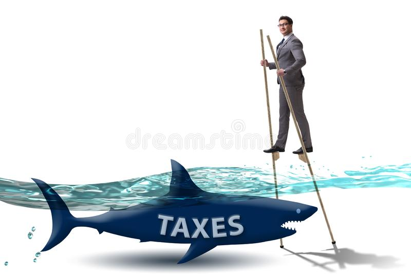 Ο επιχειρηματίας που αποφεύγει πληρώνοντας τις υψηλές φορολογίες στοκ εικόνες
