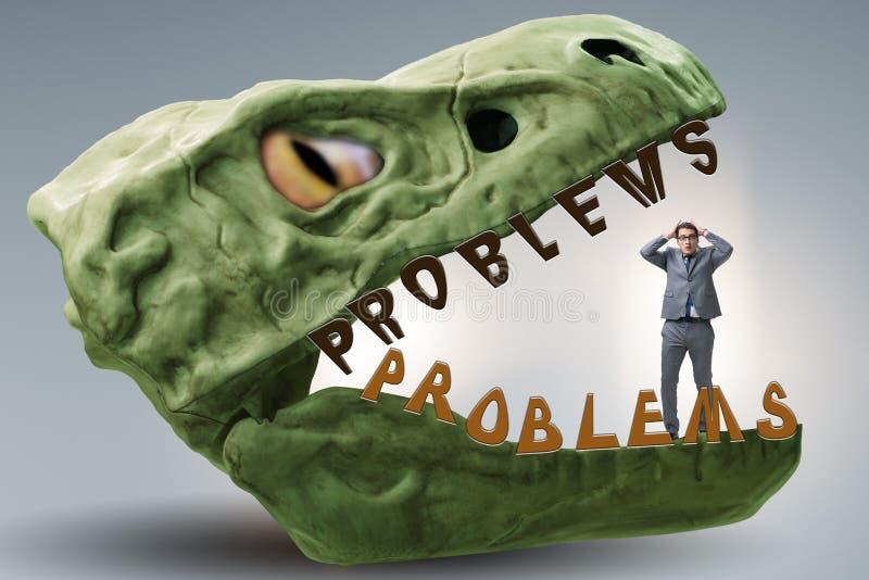 Ο επιχειρηματίας στα σαγόνια των προβλημάτων στοκ εικόνες