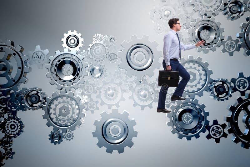 Ο επιχειρηματίας στην έννοια ομαδικής εργασίας με τις ρόδες βαραίνω στοκ εικόνα