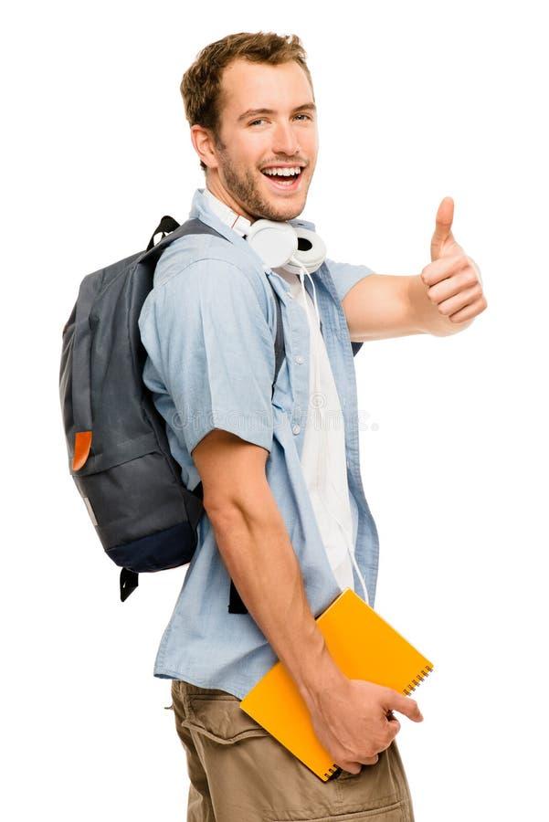 Ο ευτυχής νέος άνδρας σπουδαστής που δίνει τους αντίχειρες υπογράφει επάνω στοκ φωτογραφία