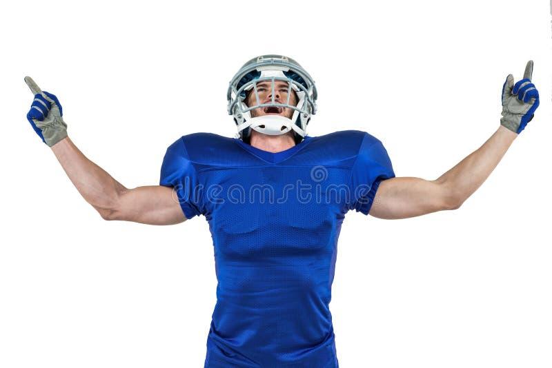 Ο ευτυχής φορέας αμερικανικού ποδοσφαίρου με τα όπλα στοκ εικόνα με δικαίωμα ελεύθερης χρήσης