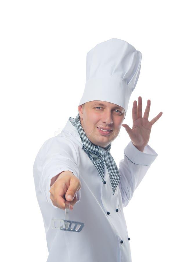ο εύθυμος μάγειρας, κρατά μια συσκευή στο χέρι του, για τη στροφή cutlets στοκ φωτογραφία με δικαίωμα ελεύθερης χρήσης