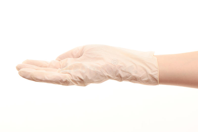 Ο θηλυκός γιατρός παραδίδει το άσπρο αποστειρωμένο χειρουργικό γάντι στοκ εικόνες