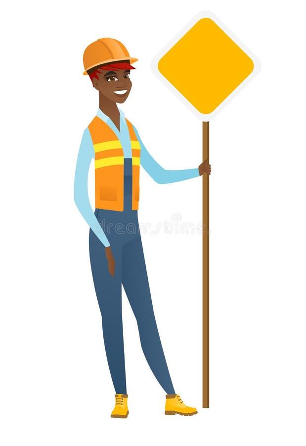Οδικός εργαζόμενος αφροαμερικάνων που παρουσιάζει οδικό σημάδι ελεύθερη απεικόνιση δικαιώματος