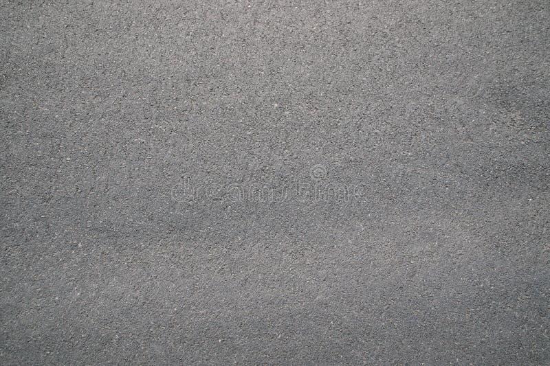 Οδικό πάτωμα ασφάλτου για τη σύσταση και το υπόβαθρο στοκ εικόνα