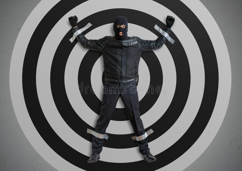 Ο κλέφτης ή ο διαρρήκτης που καλύπτεται με balaclava πιάνεται και δένεται με ταινία στο στόχο με την ταινία αγωγών στοκ εικόνες με δικαίωμα ελεύθερης χρήσης