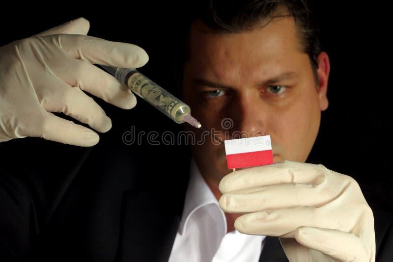 Ο νέος επιχειρηματίας δίνει μια οικονομική έγχυση στην πολωνική σημαία ISO στοκ φωτογραφίες με δικαίωμα ελεύθερης χρήσης