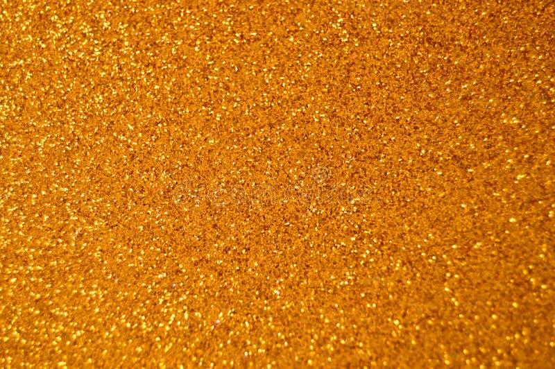 Ο νέος χρυσός έτους Χριστουγέννων ακτινοβολεί υπόβαθρο Αφηρημένο ύφασμα σύστασης διακοπών στοκ φωτογραφίες