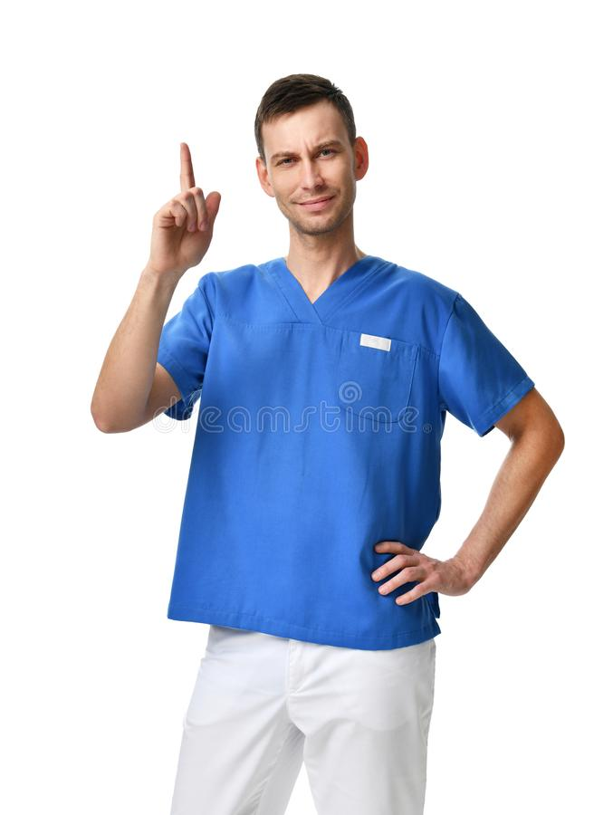 Ο οδοντίατρος γιατρών που συστήνει το νέο τρόπο της επεξεργασίας με την παρουσίαση ενός δάχτυλου υπογράφει επάνω στοκ εικόνα με δικαίωμα ελεύθερης χρήσης