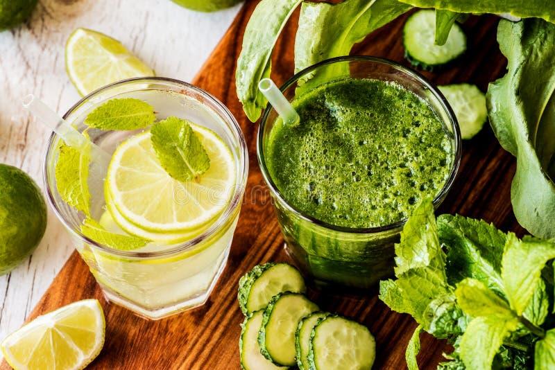 Ο πράσινος καταφερτζής και detox ποτίζει με τον ασβέστη, τη μέντα και τον πάγο στο ξύλινο υπόβαθρο Διατροφή Detox Κινηματογράφηση στοκ φωτογραφία με δικαίωμα ελεύθερης χρήσης