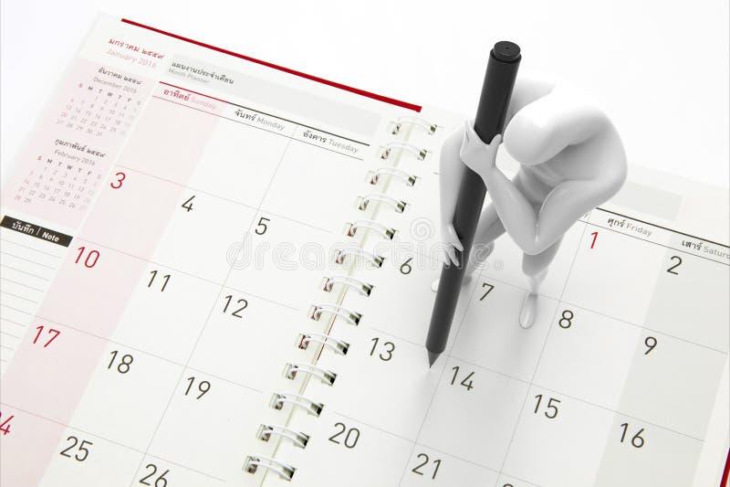 Ο προγραμματισμός ατόμων στο ημερολόγιο στοκ εικόνα
