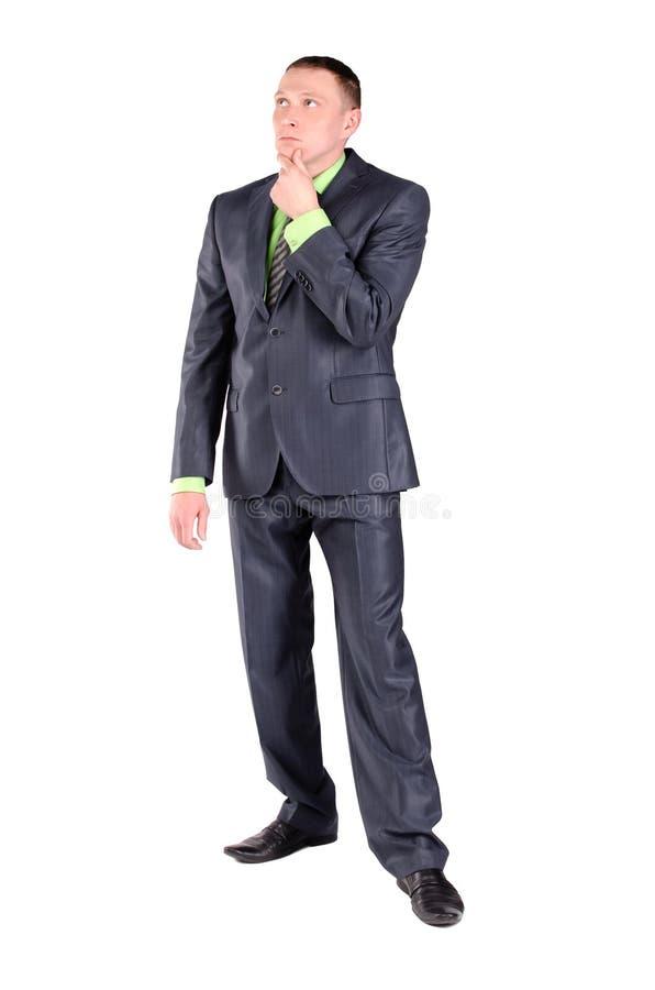 Ο σκεπτικός επιχειρηματίας σκέφτεται απομονωμένος στοκ φωτογραφία
