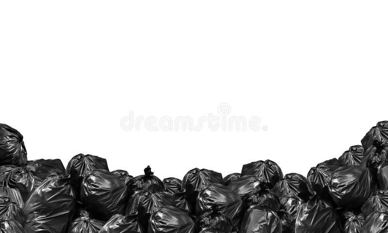 Ο σωρός του Μαύρου τσαντών απορριμάτων απομόνωσε το άσπρο διάστημα υποβάθρου και αντιγράφων για το έμβλημα, απορρίμματα, δοχείο,  στοκ εικόνες