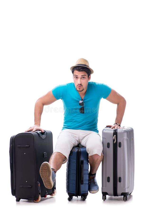 Ο ταξιδιώτης με πολλές αποσκευές που απομονώνεται στο άσπρο υπόβαθρο στοκ φωτογραφίες