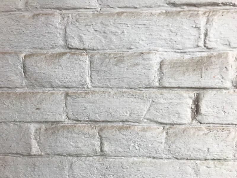 Ο τοίχος από τούβλα είναι λίγο σκονισμένος στοκ εικόνα