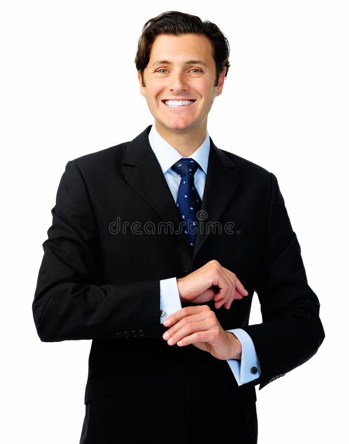 Download Ο χαλαρωμένος επιχειρηματίας διενεργεί τις προσαρμογές ενδυμασίας Στοκ Εικόνα - εικόνα από πορτρέτο, σίγουρος: 22775077