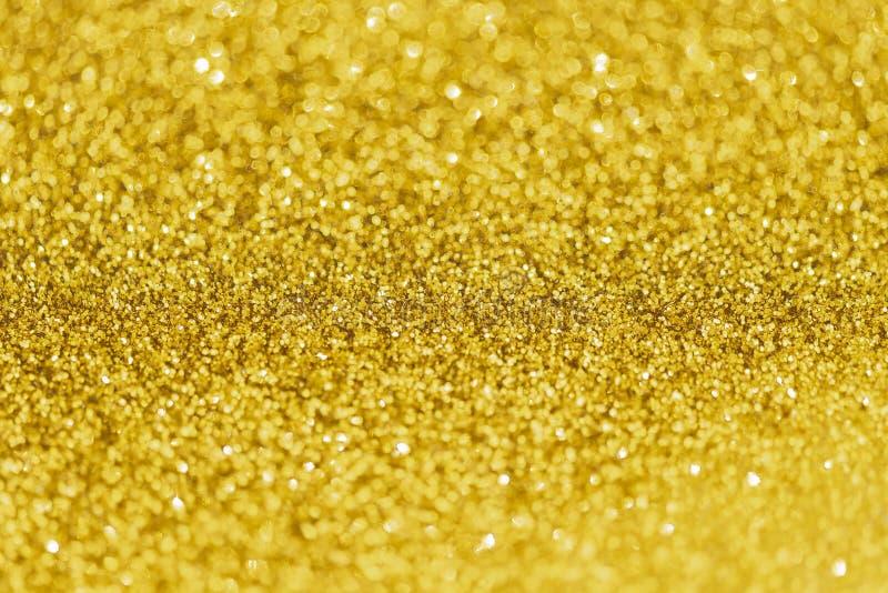 Ο χρυσός ακτινοβολεί bokeh αφηρημένο ελαφρύ υπόβαθρο στοκ εικόνες