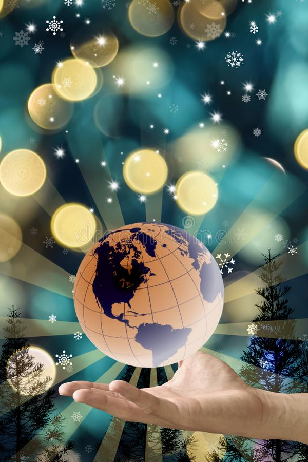 Ο χρόνος Χριστουγέννων για την παγκόσμια έννοια, χέρι φέρνει τη γη στοκ εικόνες με δικαίωμα ελεύθερης χρήσης