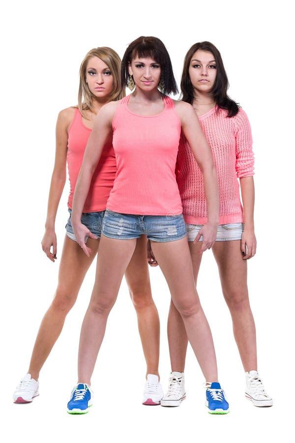 Ολόκληρο πορτρέτο τριών προκλητικών νέων γυναικών στοκ εικόνα με δικαίωμα ελεύθερης χρήσης