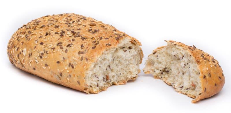 Ολόκληρο ψωμί σιταριού που σπάζουν στοκ εικόνα