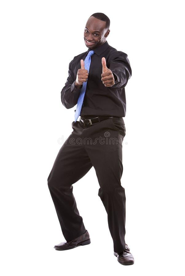 Ο όμορφος μαύρος επιχειρηματίας φυλλομετρεί επάνω στοκ εικόνες με δικαίωμα ελεύθερης χρήσης