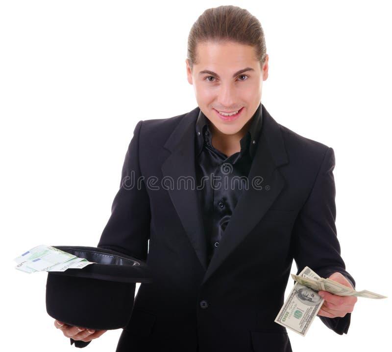 Πάρτε τα χρήματα από ένα καπέλο. Δολάρια ή ευρώ στοκ εικόνα με δικαίωμα ελεύθερης χρήσης