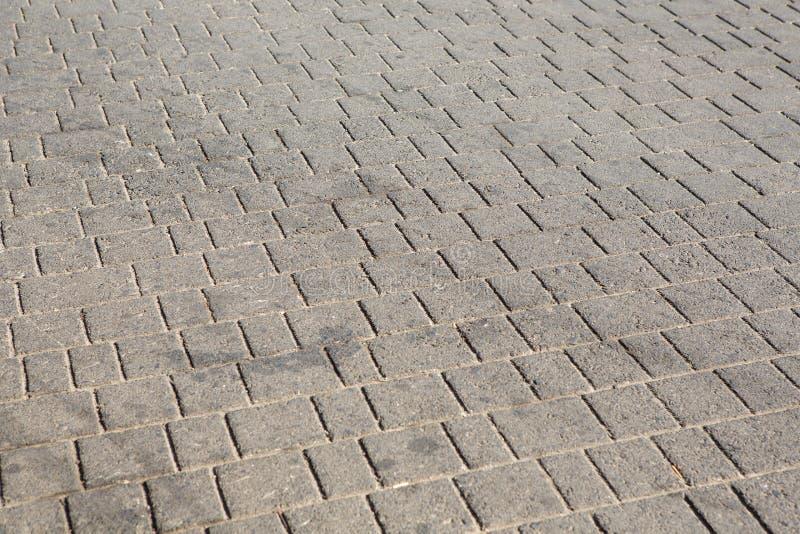 Πέτρες επίστρωσης τούβλου σε μια σύσταση υποβάθρου πεζοδρομίων στοκ φωτογραφίες με δικαίωμα ελεύθερης χρήσης