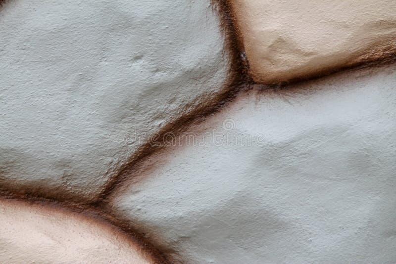 Πέτρινη σύσταση τοίχων στο καφετί χρώμα και ρόδινο πλήθος χρωμάτων για το υπόβαθρο στοκ φωτογραφία με δικαίωμα ελεύθερης χρήσης