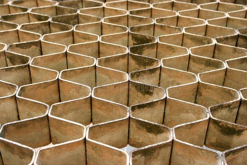 Πέτρινοι φραγμοί που διαμορφώνουν το σχέδιο χτενών μελιού στοκ εικόνα