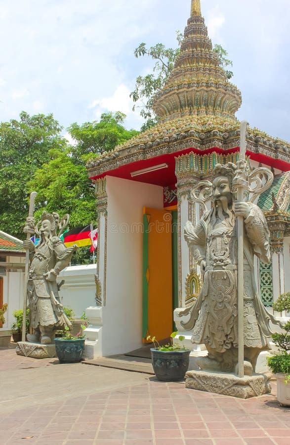 Πέτρινο άγαλμα φυλάκων σε Wat Phra Kaew, ναός του σμαραγδένιου Βούδα, μεγάλο παλάτι, Μπανγκόκ, Ταϊλάνδη στοκ εικόνες