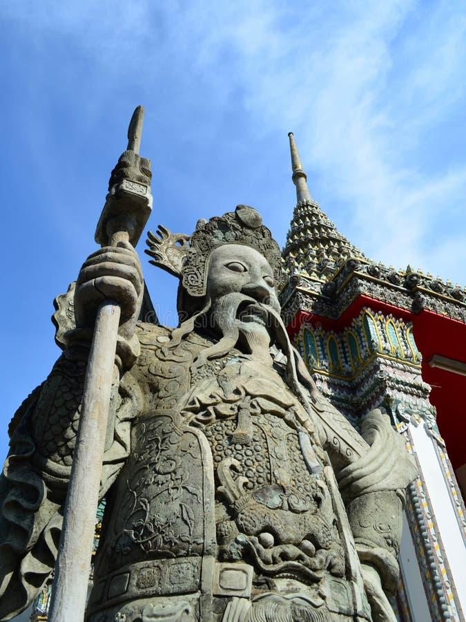 Πέτρινο γλυπτό του κινεζικού φύλακα στην είσοδο Wat Pho, στοκ φωτογραφία με δικαίωμα ελεύθερης χρήσης