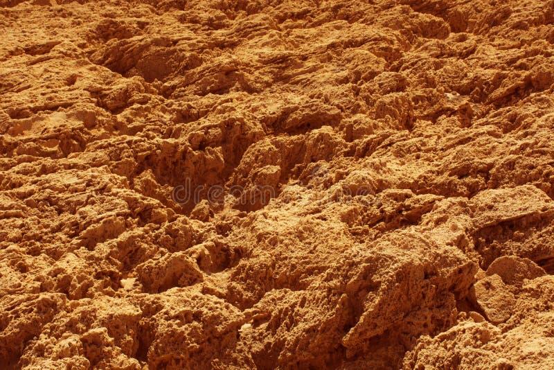 Πέτρινο πορτοκαλί υπόβαθρο επιφάνειας, ανώμαλη σύσταση βράχου στοκ φωτογραφίες με δικαίωμα ελεύθερης χρήσης