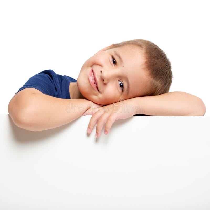 Πίνακας διαφημίσεων με ένα ευτυχές παιδί στην κορυφή στοκ φωτογραφία με δικαίωμα ελεύθερης χρήσης