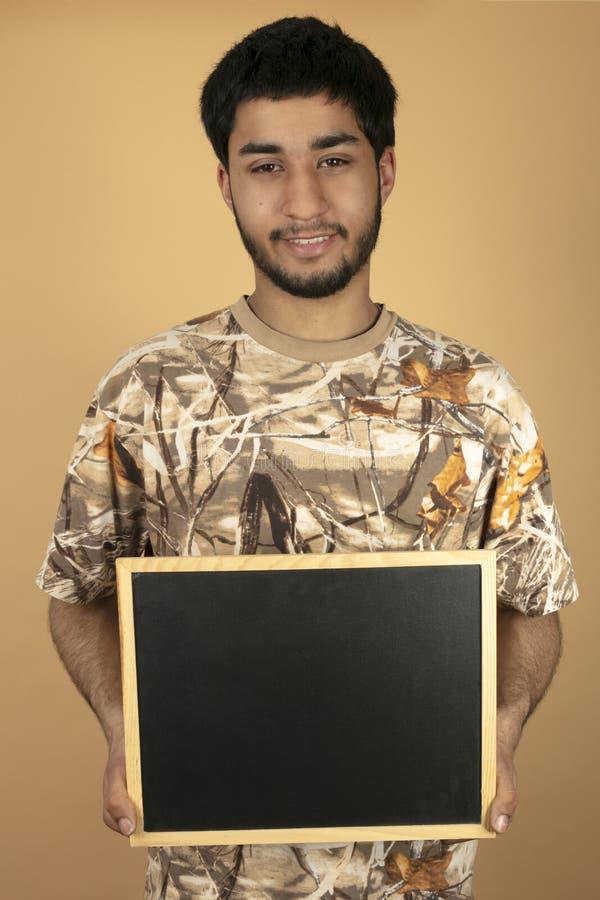Πίνακας εκμετάλλευσης νεαρών άνδρων στοκ φωτογραφία με δικαίωμα ελεύθερης χρήσης