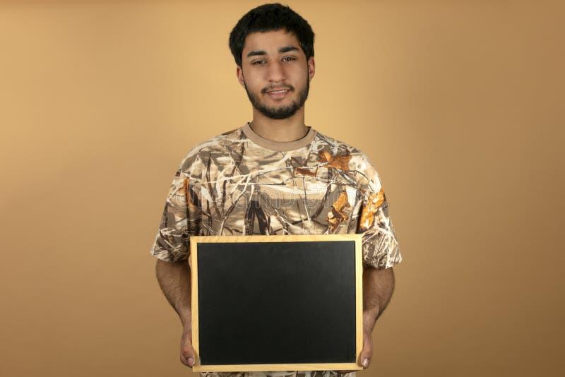 Πίνακας εκμετάλλευσης νεαρών άνδρων στοκ φωτογραφίες με δικαίωμα ελεύθερης χρήσης