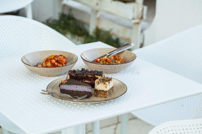Πίνακας καφέδων Vegan Χορτοφάγα τρόφιμα και επιδόρπια στοκ εικόνα με δικαίωμα ελεύθερης χρήσης