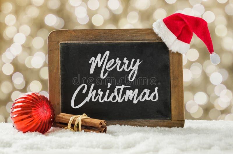 Πίνακας με τις διακοσμήσεις Χριστουγέννων στο χιόνι στοκ φωτογραφίες