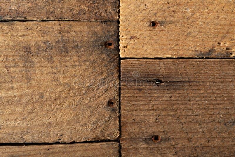 Πίνακας φιαγμένος από ξύλινες παλαιές σανίδες Μια επιφάνεια που καλύπτεται επίπεδη με το ξύλο στοκ εικόνα με δικαίωμα ελεύθερης χρήσης