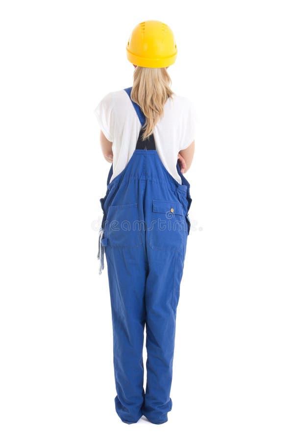 Πίσω άποψη της γυναίκας στον μπλε οικοδόμο ομοιόμορφο που απομονώνει στο λευκό στοκ φωτογραφία με δικαίωμα ελεύθερης χρήσης