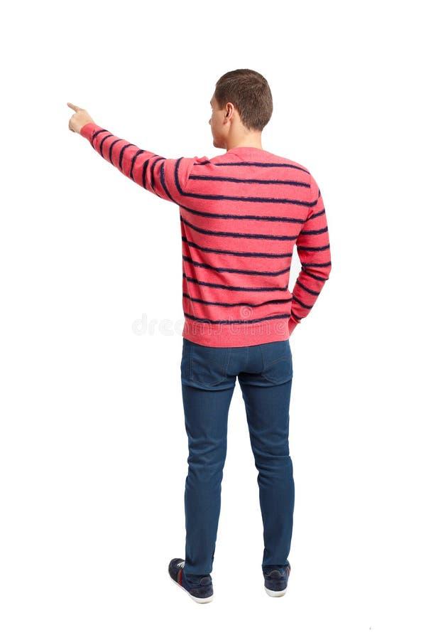 Πίσω άποψη της υπόδειξης των νεαρών άνδρων στο πουκάμισο και τα τζιν στοκ εικόνες