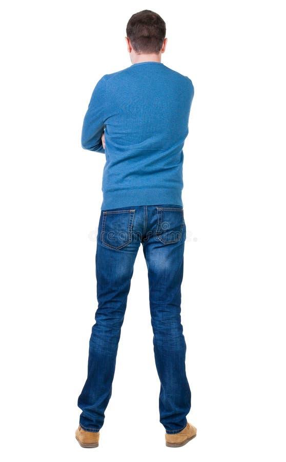 Πίσω άποψη του όμορφου ατόμου στο μπλε πουλόβερ που ανατρέχει στοκ φωτογραφία