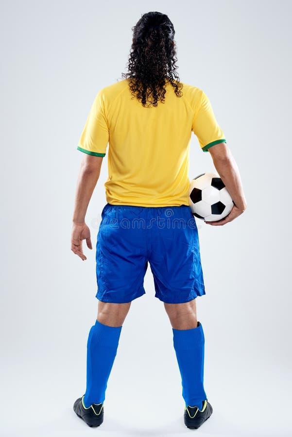 Πίσω άτομο ποδοσφαίρου άποψης στοκ εικόνα