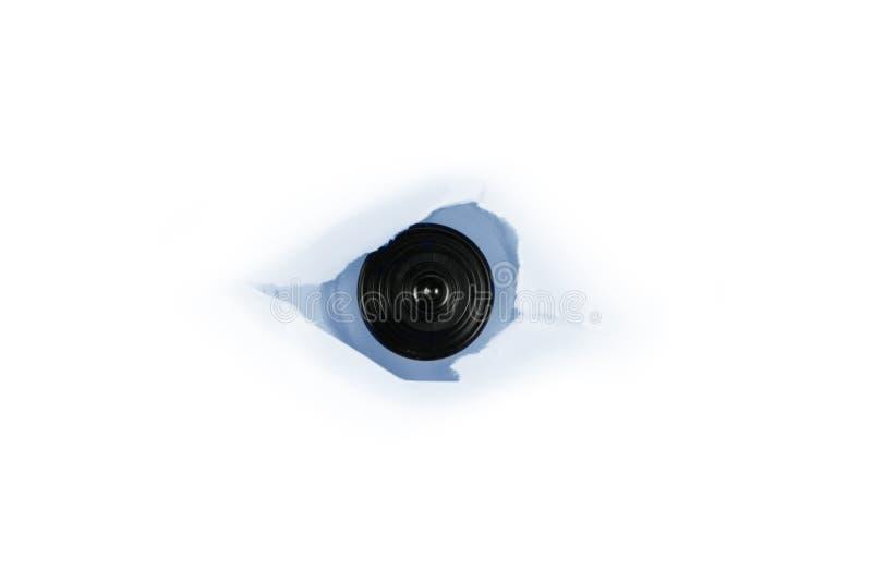 πίσω από τον Ιστό κατασκόπων εγγράφου τρυπών ματιών εκκέντρων στοκ εικόνα με δικαίωμα ελεύθερης χρήσης