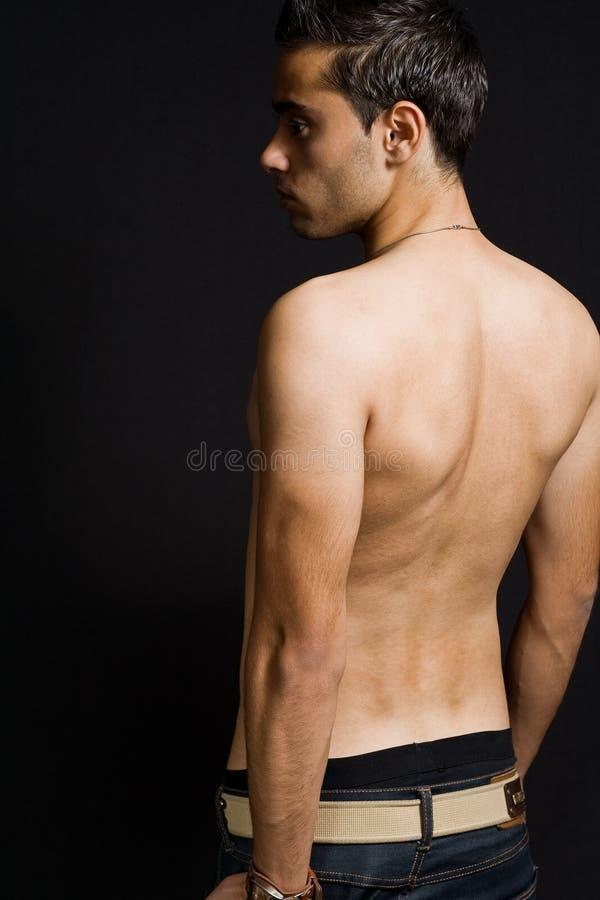 πίσω αρσενικός προκλητικός ατόμων στοκ εικόνες