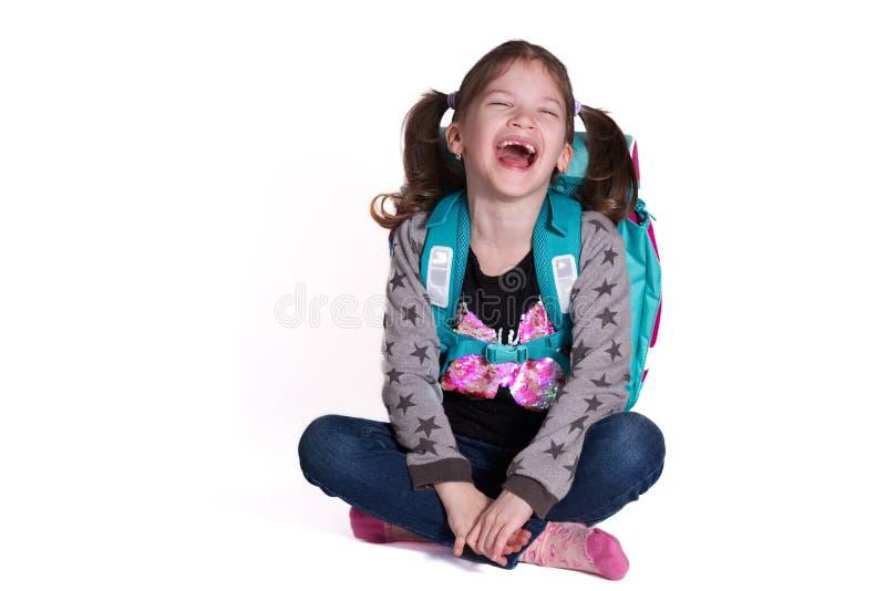 Πίσω στο σχολείο - λίγο χαμογελώντας κορίτσι στοκ εικόνα με δικαίωμα ελεύθερης χρήσης