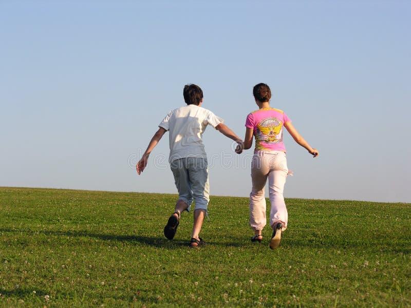 πίσω τρέξιμο ζευγών στοκ φωτογραφίες