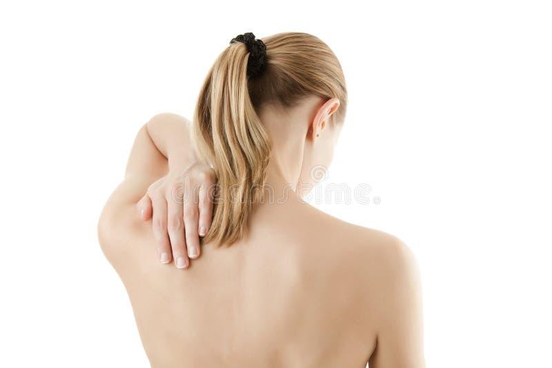 πίσω τρίβοντας γυναίκα πόν&omicro στοκ εικόνες