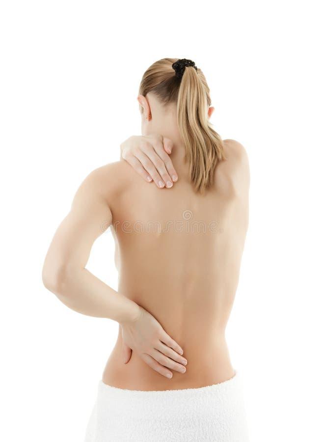 πίσω τρίβοντας γυναίκα πόν&omicro στοκ φωτογραφία με δικαίωμα ελεύθερης χρήσης