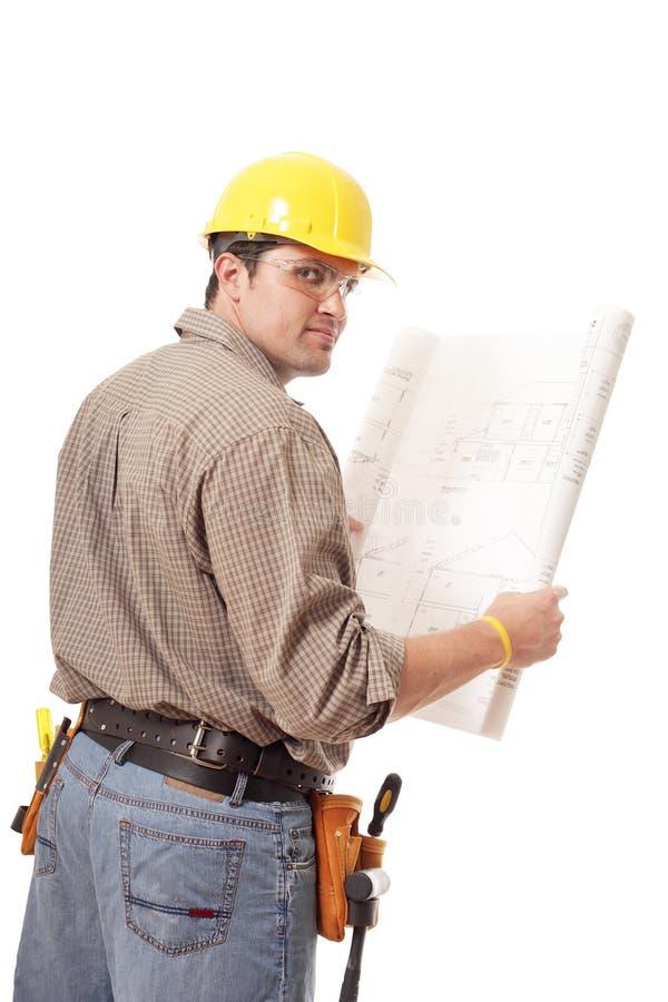 Πίσω όψη του εργαζομένου με τα σχεδιαγράμματα στοκ φωτογραφία με δικαίωμα ελεύθερης χρήσης